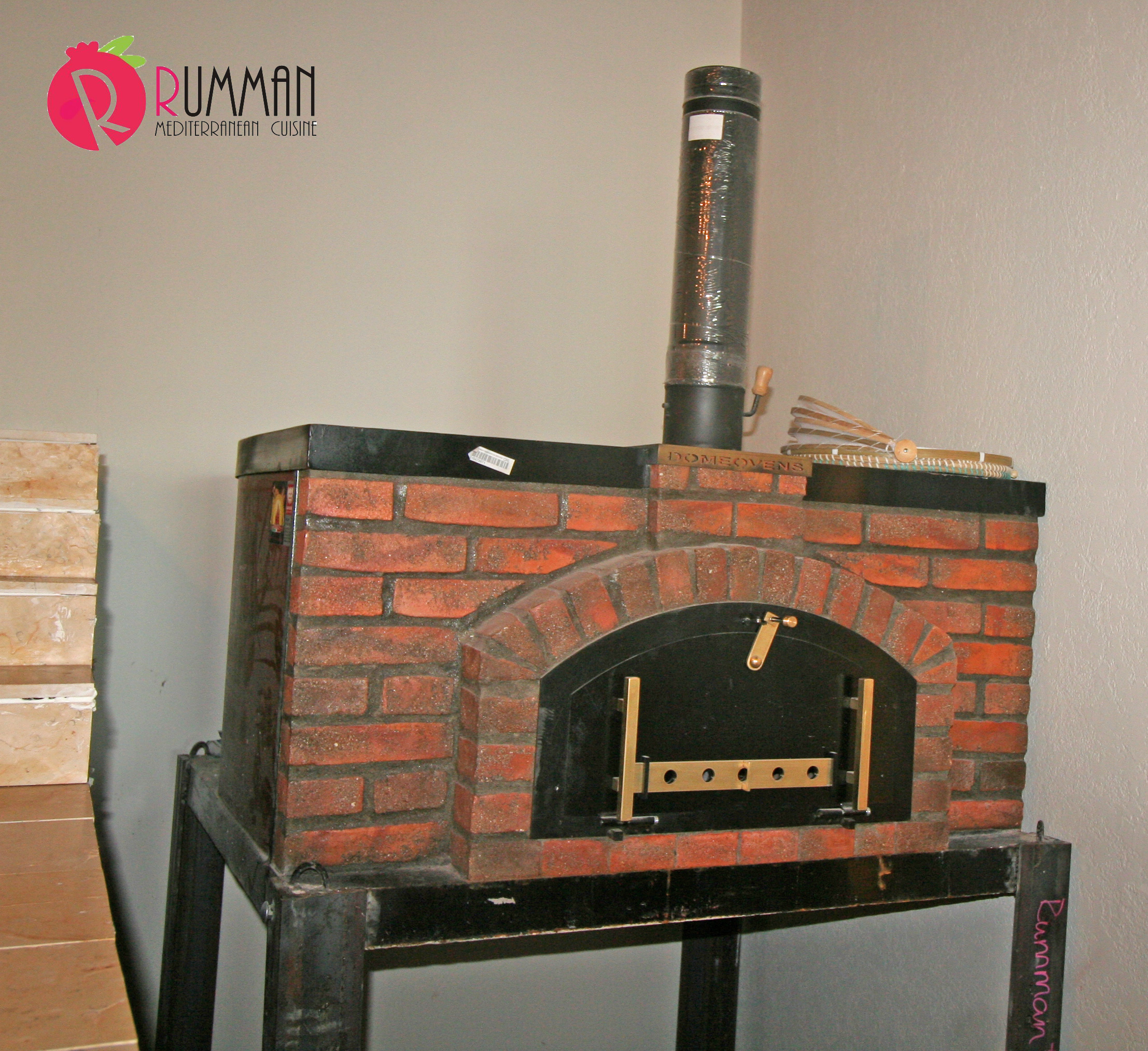 Rumman is a space filled with beautiful design details, smells of fresh baked pita from the wood oven,