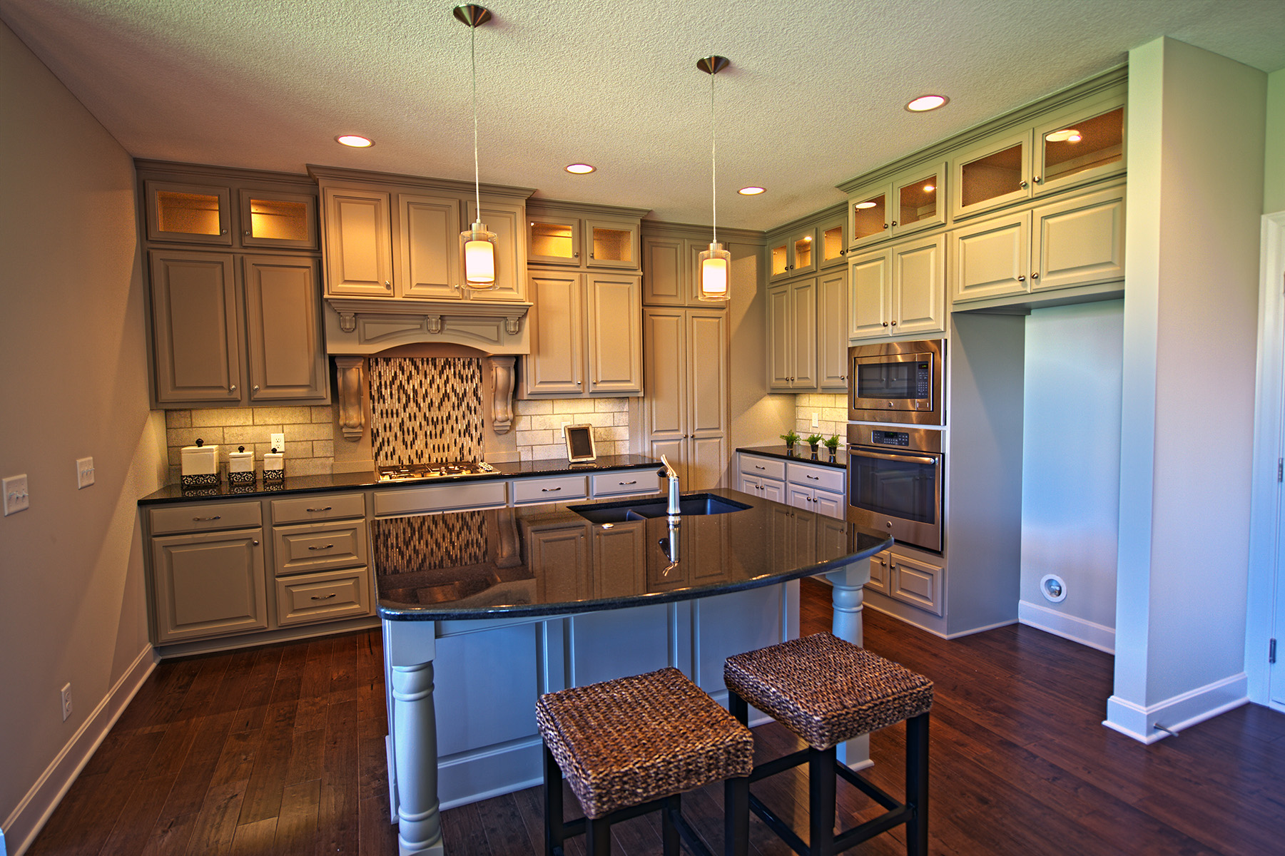 Reilly Home Builders, Canaan Stone Works, kitchen island, granite counter tops, natural light, nuteral cabinets, custom granite countertops